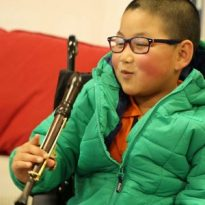 Disabled children learn on adapted musical instruments in S4E Music Service programme